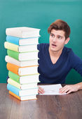 Shocked Student Looking At Books — Stock Photo