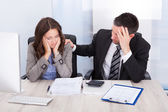 Worried Businesspeople Calculating Finance — Stock Photo