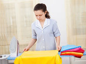 Young Woman Ironing Clothes — Stock Photo