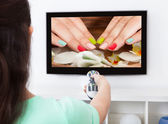 Woman Changing Television Channel — Stock Photo