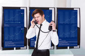 Angry Stock Broker Talking On Telephone — Stock Photo
