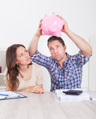 Couple Expecting Money From Piggybank — Stock Photo