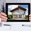 Architect Showing Picture Of House — Stock Photo #38712511