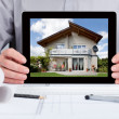 Architect Showing Picture Of House — Stock Photo