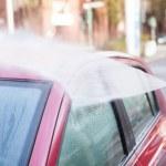 Hose Spraying Water On Car — Stock Photo #38712595