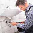 Stock Photo: Plumber Fitting Sink Pipe