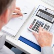 Businessman Calculating Finance — Stock Photo #38713747