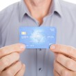 Mature Businessman Showing Credit Card — Stock Photo
