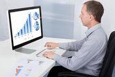 Businessman Analyzing Graph On Computer — Stock Photo