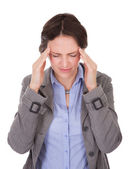 Businesswoman Suffering From Headache — Stok fotoğraf