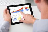 Businessman Analyzing Graph On Digital Tablet — Stock Photo