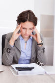 Thoughtful Businesswoman Doing Calculations — Foto Stock