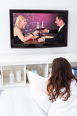 Woman Watching Movie On Television — Stock Photo