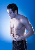Hombre que tenía dolor de estómago — Foto de Stock