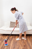 Young Maid Cleaning Floor — Стоковое фото