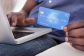 Hand With Laptop And Credit Card — Stock Photo