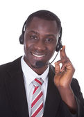 African Businessman Wearing Headset — Stock Photo