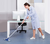 Maid Cleaning Floor In Office — Stock Photo