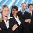 Confident business team with headsets — Stock Photo #39130399