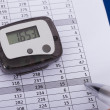 Hand Over Sheet With Digital Pedometer — Stock Photo