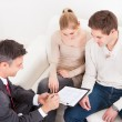 Consultant Showing Agreement To Couple — Stock Photo #39130887