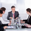 Businesspeople Sitting At Conference Table — Stock Photo #39131199
