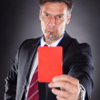Businessman Showing Red Card — Stock Photo