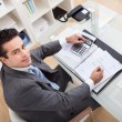 Businessman Working At Desk — Stock Photo #39131479