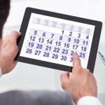 Businessman Looking At Calendar On Digital Tablet — Stock Photo #39131757