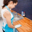 Stock Photo: WomCleaning Kitchen Countertop