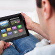 Man Holding Tablet Pc With Icons — Stockfoto