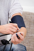 Man Checking Blood Pressure — Stock Photo