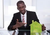 Businessman Presenting Ecological House — Stock Photo