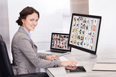 Businesswoman Browsing Pictures — Stock Photo