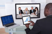 Businessman In Conference Analyzing Graph — Foto de Stock