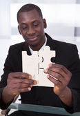 Businessman Holding Jigsaw Puzzle — Stock Photo
