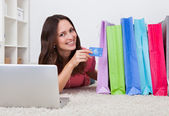 Woman With Shopping Bags And Credit Card — Stock Photo
