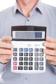 Businessman Showing Figures On Calculator — Stock Photo
