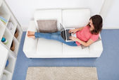 Woman Sitting On Couch Using Laptop — Stock Photo