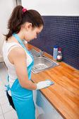 Woman Cleaning Kitchen Countertop — Stock Photo