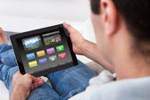 Man Holding Tablet Pc With Icons — Stock Photo
