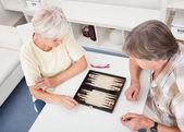 Senior Couple Playing Backgammon — ストック写真