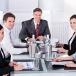 Businesspeople Sitting At Conference Table — Stock Photo #39410519