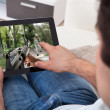 Man Playing Game On Tablet Pc — Stock Photo