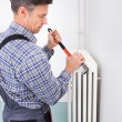 Plumber Fixing Radiator — Stock Photo