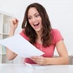 Happy Woman Reading Paper — Stock Photo