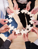 Business People Holding Jigsaw Puzzle — Stock Photo