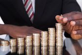 Businessman Stacking Coins — Stock Photo