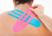 Applying Special Physio Tape On Man's Back — Stock Photo