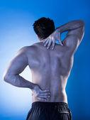 Hombre que sufre de dolor de espalda — Foto de Stock